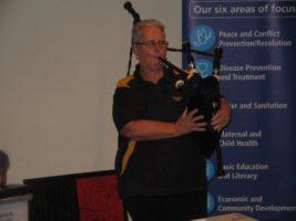 Rotarian Judy C & Bagpipes